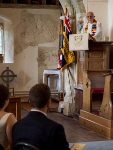 Vicar preaches from pulpit during classic English country church wedding