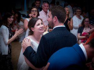 Bride looks adoringly at groom  while dancing at wedding reception
