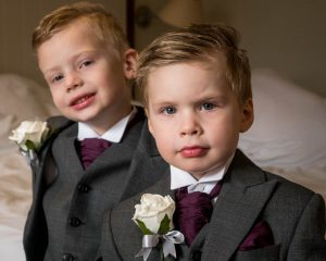 Two little boys dressed in morning suits as page boys