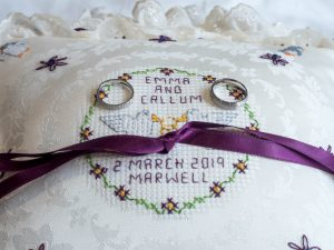 Embrodered wedding  ring cushion with rings
