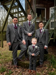 Groomsmen pose on fire escape at Marwell Hotel
