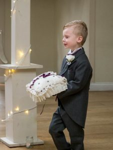 Page boy in morning suite carries rings into wedding at Marwell Hotel