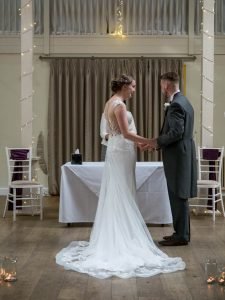 Bride and groom say their vows during wedding at Marwell hotel