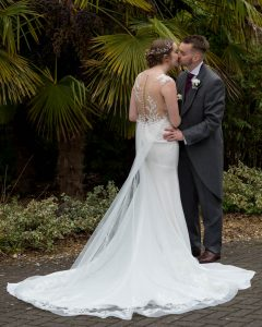 Bride and groom kiss outside Marwell Hotel