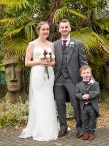 Bride and groom with nephew