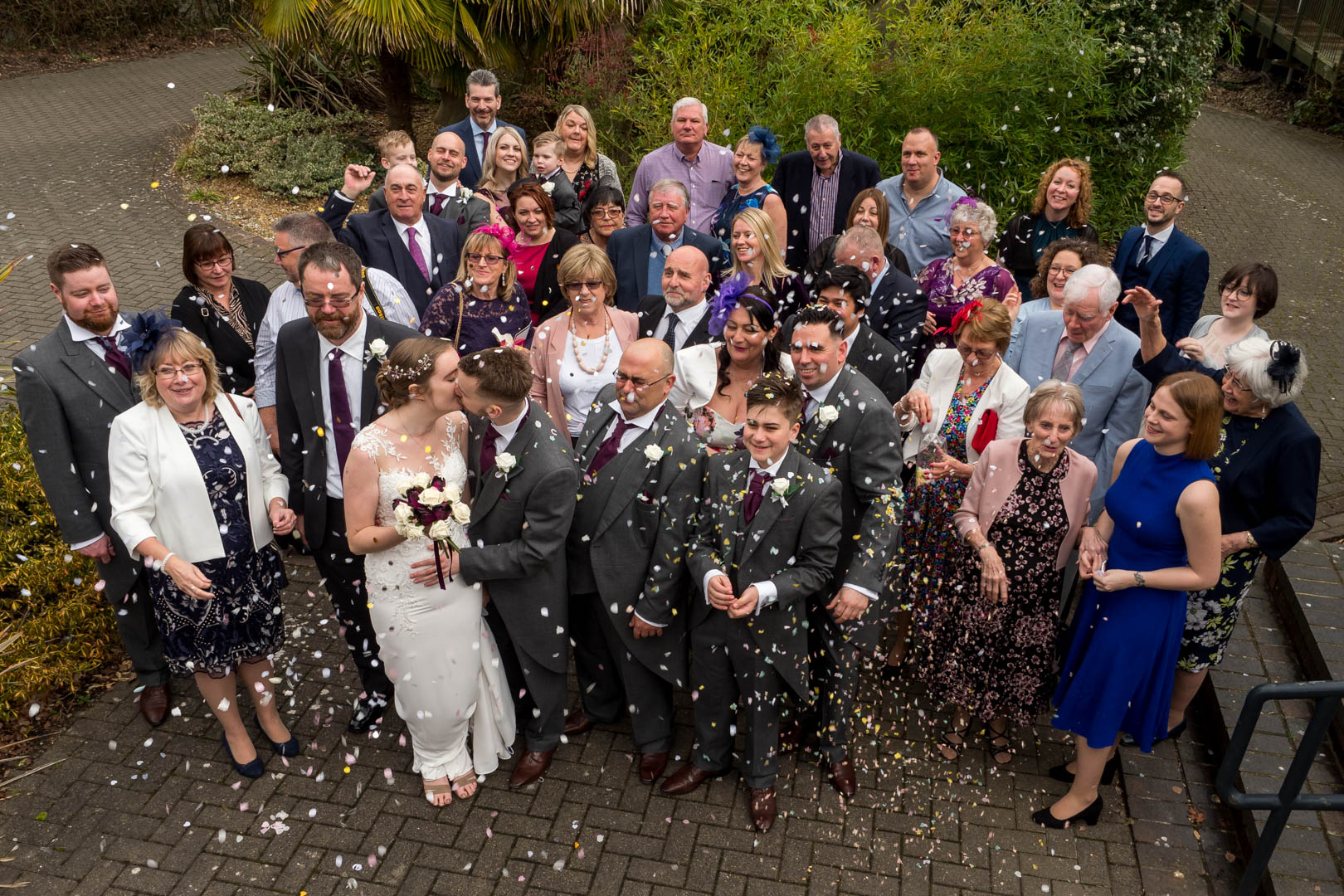 Bride and groom beneath confetti shower at Marwell Hotel