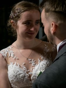 Bride looks lovingly at groom