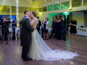 Bride and groom kiss during first dance at Marwell Hotel