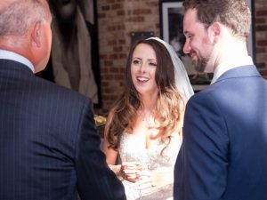 Bride greets wedding guests at reception