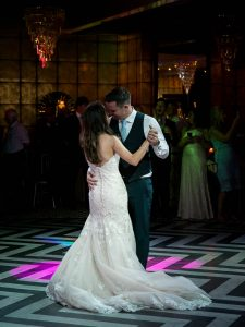 Bride and groom enjoy their first dance together at the Old Thorns Hotel, Liphook