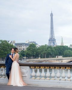 Elegant couple in wedding dress on the Pont Aleandre III with the Eiffel Tower in the background