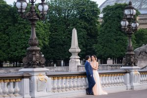 Elegant couple in wedding dress on the Pont Aleandre III with the Grand Palais in the background