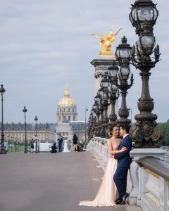 Elegant couple in wedding dress on the Pont Aleandre III with Les Invalides in the background