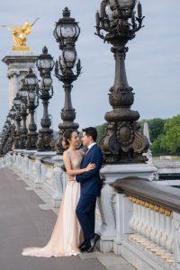 Elegant couple in wedding dress on the Pont Aleandre III