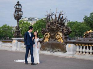 Oriental couple in wedding dress on the Pont Aleandre III