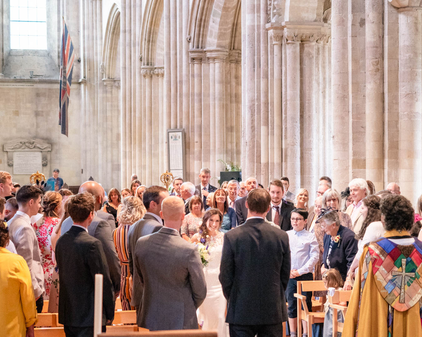 A bride greets her bridegroom at their wedding in Romsey Abbey