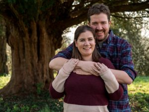 Rural Hampshire engagement shoot – man with arms around woman