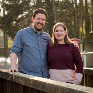 Rural Hampshire engagement shoot – backlit couple on wooden bridge