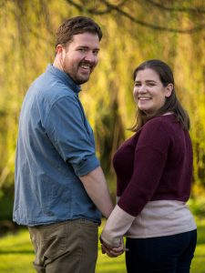 Rural Hampshire engagement shoot – couple hold hands in front of weepin willows