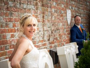 Bride and groom pose for photos after rustic barn wedding ceremony at The Three Tuns, Bransgore