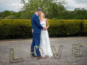 Bride and groom kiss after rustic barn wedding ceremony at The Three Tuns, Bransgore