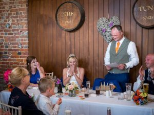 Groom makes speech during rustic barn wedding reception at the Three Tuns, Bransgore