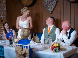 Bride makes speech during rustic barn wedding reception at the Three Tuns, Bransgore