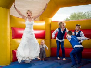 Bride and family on bouncy castle at The Three Tuns, Bransgore