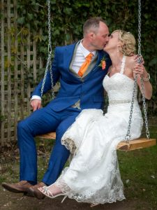 Bride and groom  on swing at The Three Tuns, Bransgore
