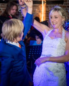 Bride dances with her son at The Three Tuns, Bransgore