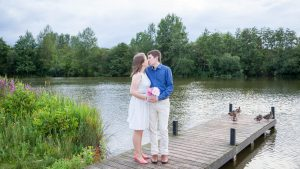 Couple kiss on a jetty in Eastleigh Lakeside Country Park