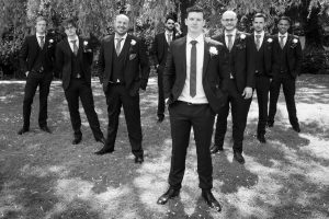 Groomsmen in Reservoir Dogs v-formation before a Gordleton Mill wedding
