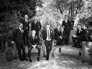 Groomsmen strike a Bullingdon Club pose before a Gordleton Mill wedding
