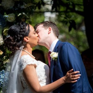 Bride and groom kiss during their Gordleton Mill wedding cerenony