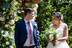 Bride and groom relax at the end of their Gordleton Mill wedding cerenony