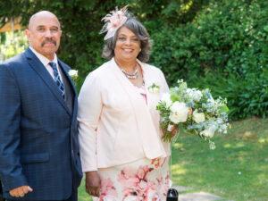 Brides parents in the garden at a Gordleton Mill wedding