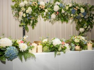 Gordleton Mill wedding reception top table decorated with hydrangeas and roses