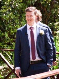 Groom smiles while waiting for bride at their Gordleton Mill wedding