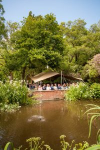 Guests beneath an awning at a Gordleton Mill wedding