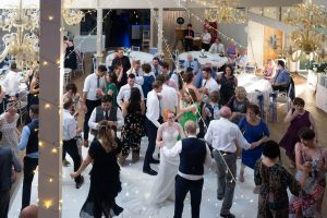 Guests dance at the end of a Marwell Hotel wedding reception