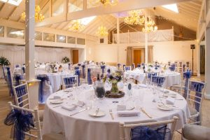 The hall at Marwell Hotel set out for a  wedding reception