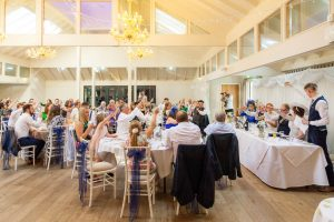 Best man toasts the bride and groom during their  Marwell Hotel wedding reception