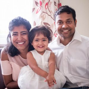 Indian father and mother with their young daughter