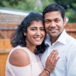 Indian couple in an English suburban back garden