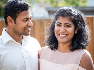 Indian man looks adoringly at his wife