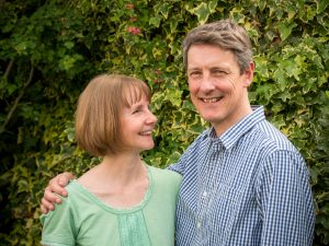 Middle-aged couple in Romsey cottage garden