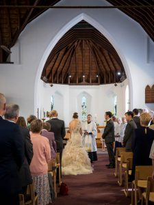 Vicar addresses bride, groom and congregation in church