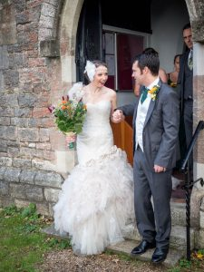 Bride and groom walk down church steps