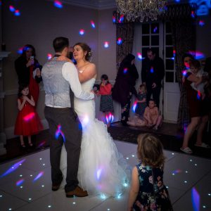 A bride and her new husband enjoy their first dance at Norton Park