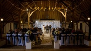 A wedding in progress in the Tithe Barn at Norton Park